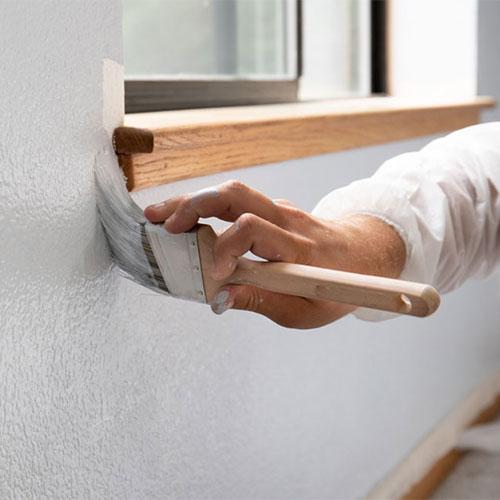 man painting interior